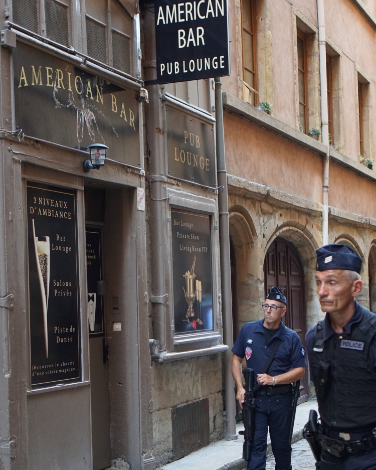 Increased police presence in Vieux Lyon and throughout the city due to excessive crowds for FIFA World Cup tournament.